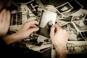 person looking at old photograph